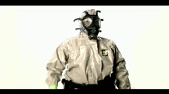 A man in a hazmat suit speaks into a walkie-talkie. Stock Footage