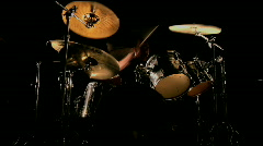 A drummer plays on a darkened stage. Stock Footage