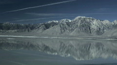 A lake in the owens valley of california reflects the mountains. - stock footage
