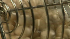 White balls turn in a bingo cage. Stock Footage