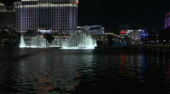 Stock Video Footage of A large, animated outdoor fountain shines in Las Vegas at night.
