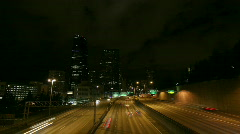 A beautiful shot of time lapsed freeway traffic in a downtown area. Stock Footage