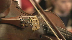 Violin bridge played with bow Stock Footage