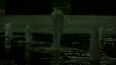 Fountain in park at night under green light Stock Footage