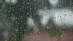 Raindrops on the window at daytime  Stock Footage