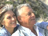 Stock Video Footage of Mature couple on beach rollfocus PAL
