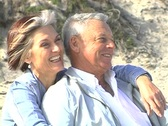 Stock Video Footage of Mature couple on beach static NTSC