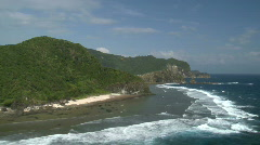 Aerial along tropical coastline with high cliffs Stock Footage