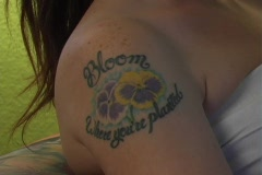 Beautiful, Sexy Brunette with Tattoos Relaxes with a Good Book (3) Stock Footage