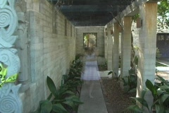 Ghostly Woman in an Outdoor Covered Walkway Stock Footage