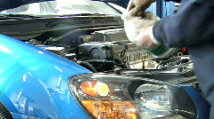 Mechanic Tops off Washer Fluid Stock Footage