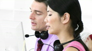 Colleagues talking in a call center Stock Footage