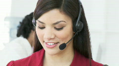 Beautiful woman working in a call center Stock Footage