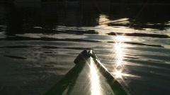 Kayak on Water with Glistening Sun Stock Footage