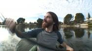 Stock Video Footage of Man Kayaking on Lake Sequence