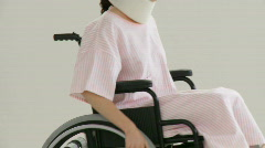 Beautiful female patient in a wheelchair Stock Footage