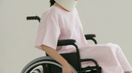 Stock Video Footage of Beautiful female patient in a wheelchair
