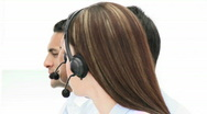 Close-up of people working in a call center Stock Footage