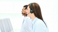 Smiling businesswoman working in a call center Stock Footage