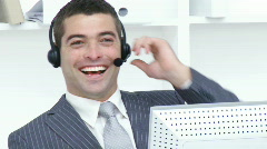 Attractive businessman working in a call center - stock footage