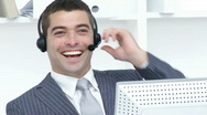 Stock Video Footage of Attractive businessman working in a call center