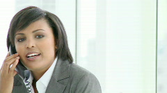 Panorama of Afro-American businesswoman talking on phone Stock Footage