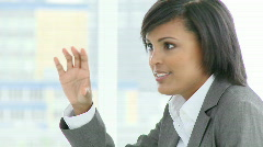 Afro-American businesswoman talking to somebody in a meeting - stock footage