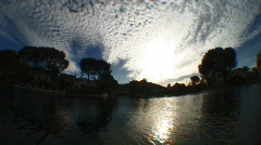 Floating on Lake with Clouds and Sun Stock Footage