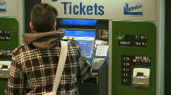 Customers use kiosk to purchase metro tickets - stock footage