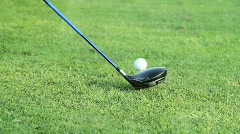 Golf tee shot low angle driver slow motion Stock Footage