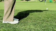 Golf chip onto green just misses the cup Stock Footage