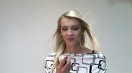 Stock Video Footage of HD1080i Blond woman talking on cell phone.