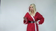 Stock Video Footage of HD1080i Sexy x-mas blond girl with chocolate cake. Bad choice.