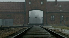 Auschwitz Birkenau Main Gate Railway Line zoom tight Stock Footage