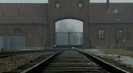 Stock Video Footage of Auschwitz Birkenau Main Gate Railway Line zoom tight