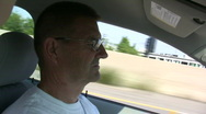 Stock Video Footage of Elderly man driving down highway