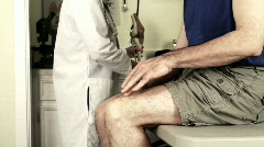 Doctor explaining knee pain to patient Stock Footage