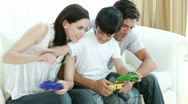 Family playing video Games at home Stock Footage