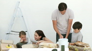 Happy family painting a room Stock Footage