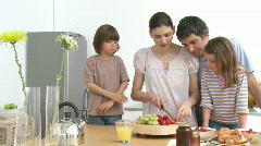 Family preparing a healthy breakfast in the kitchen Stock Footage