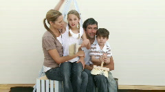 Family with brushes ready to paint a room at home - stock footage