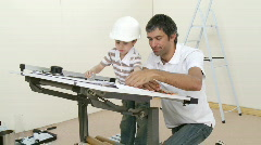 Father and son refurbishing a bedroom - stock footage