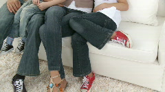 Happy family on sofa at home Stock Footage