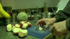 Man hands chopping red potatoes dicing into cooking pot Stock Footage