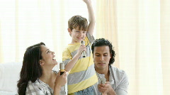 Parents and son singing at home Stock Footage