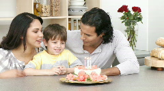 Close-up of family celebrating kid's birthday Stock Footage