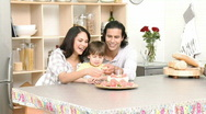 Little boy celebrating his birthday with his parents Stock Footage