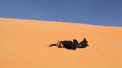 Desperate businessman in desert dunes thirsty part I Stock Footage