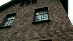 Auschwitz 1 inside pan down and round to gate from windows Stock Footage