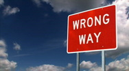 Wrong Way Sign Sky Background Stock Footage